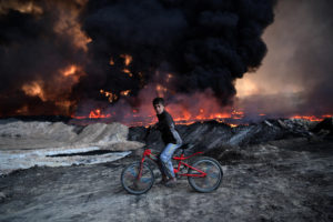 Boy and Burning Oil Field