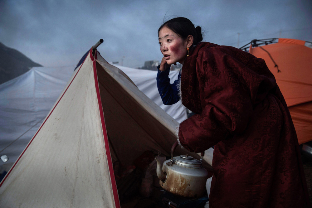 Nomad Preparing Tea from Red, Blue, White: Global Colours fine art photography