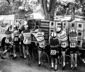 Racing Cyclists Getting Supplies