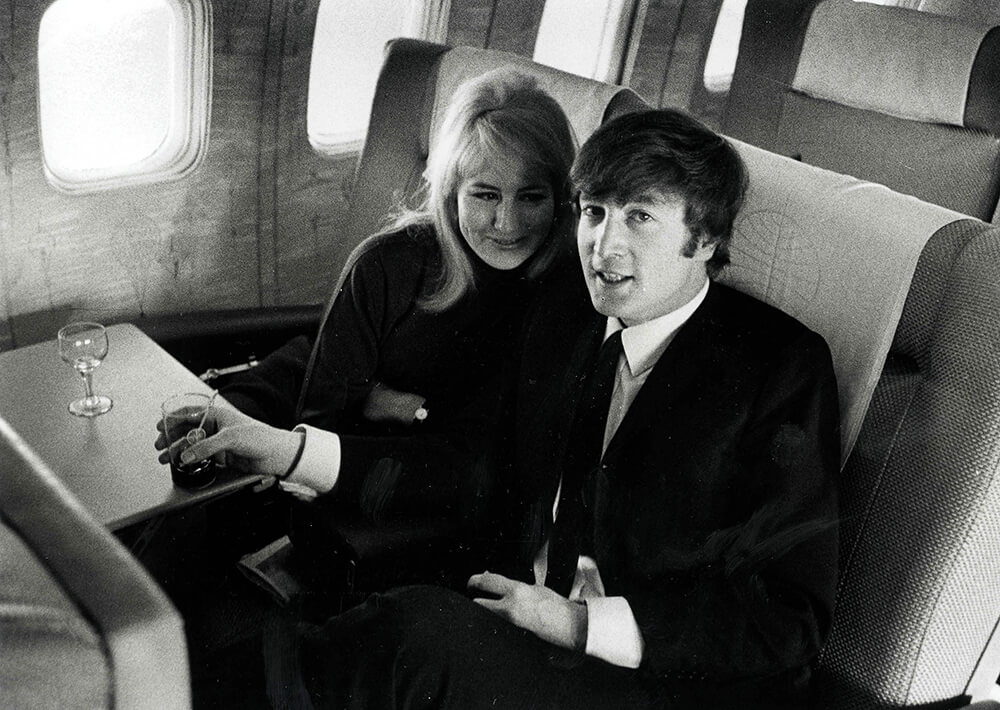 Volume 2, Page 84, Picture 6. The Beatles, February 1964. John Lennon with his wife Cynthia, flying to New York. fine art photography