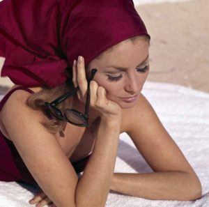 Young Woman Resting On A White Towel
