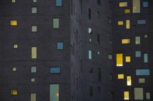 Detail of reflections in windows of a building New York City,New York photographed from the Highlline in Chelsea at sunset