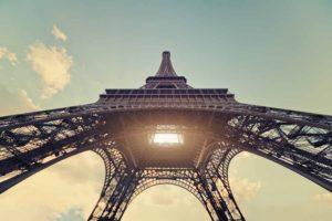 Light shining through Eiffel Tower