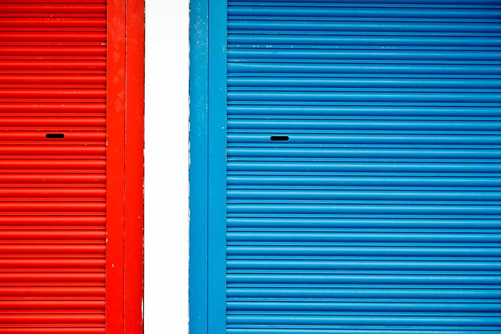 Bright red and blue roller shutters divided fine art photography