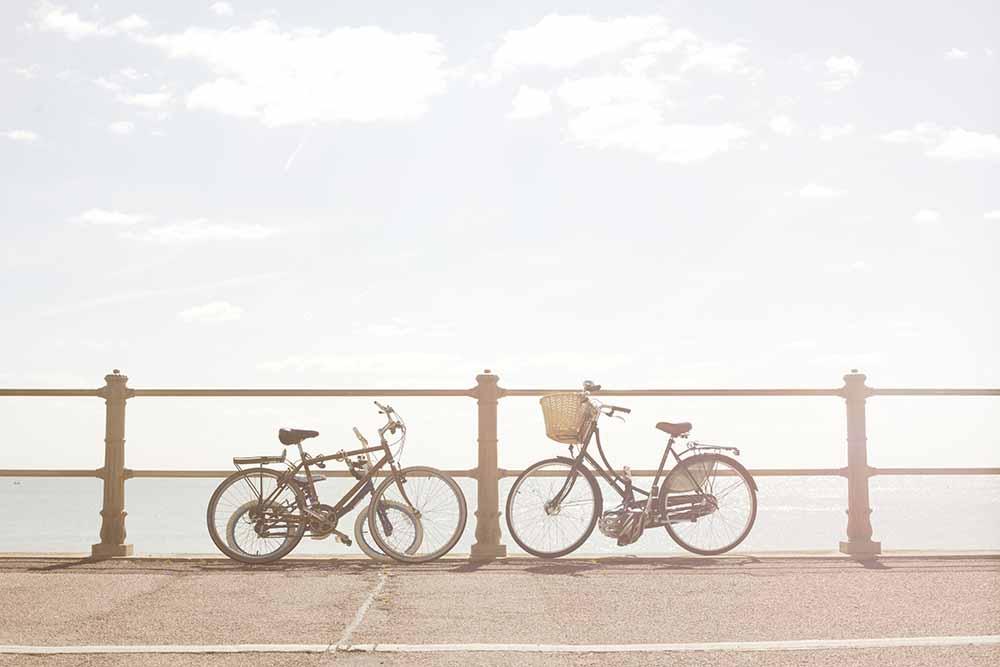 Bikes against beach railings fine art photography