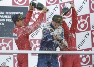 Damon Hill of the Williams Renault team enjoys the champagne shower he gets from