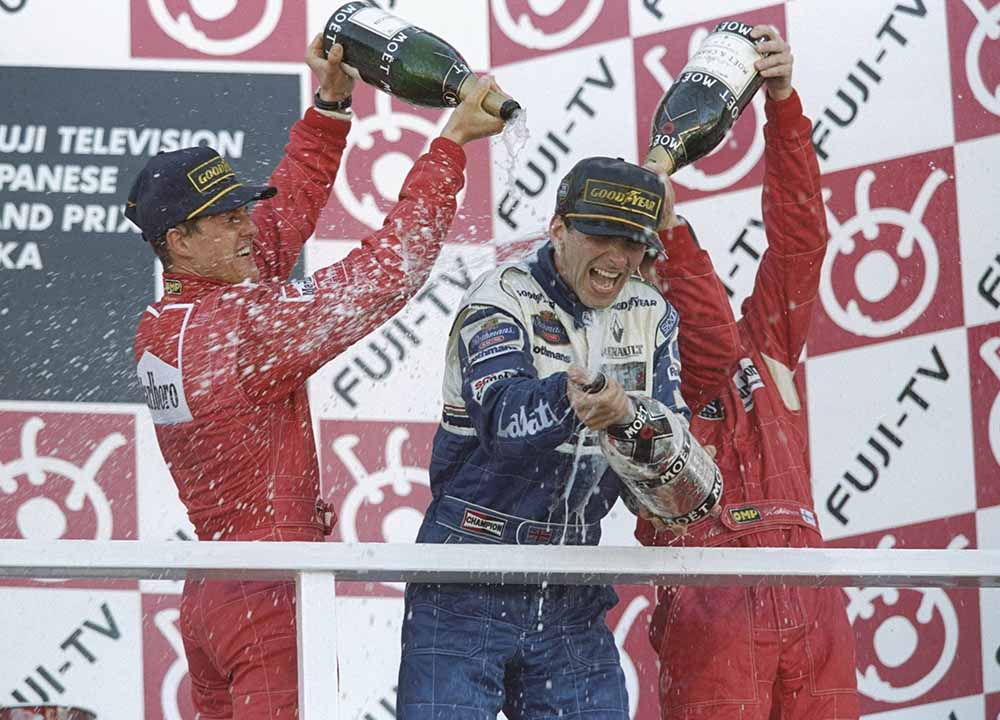 Damon Hill of the Williams Renault team enjoys the champagne shower he gets from fine art photography
