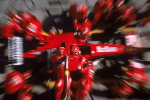 Michael Schumacher of Germany and the Ferrari team in the pits