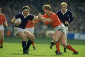 David Sole of Scotland is tackled by S Davies of Wales