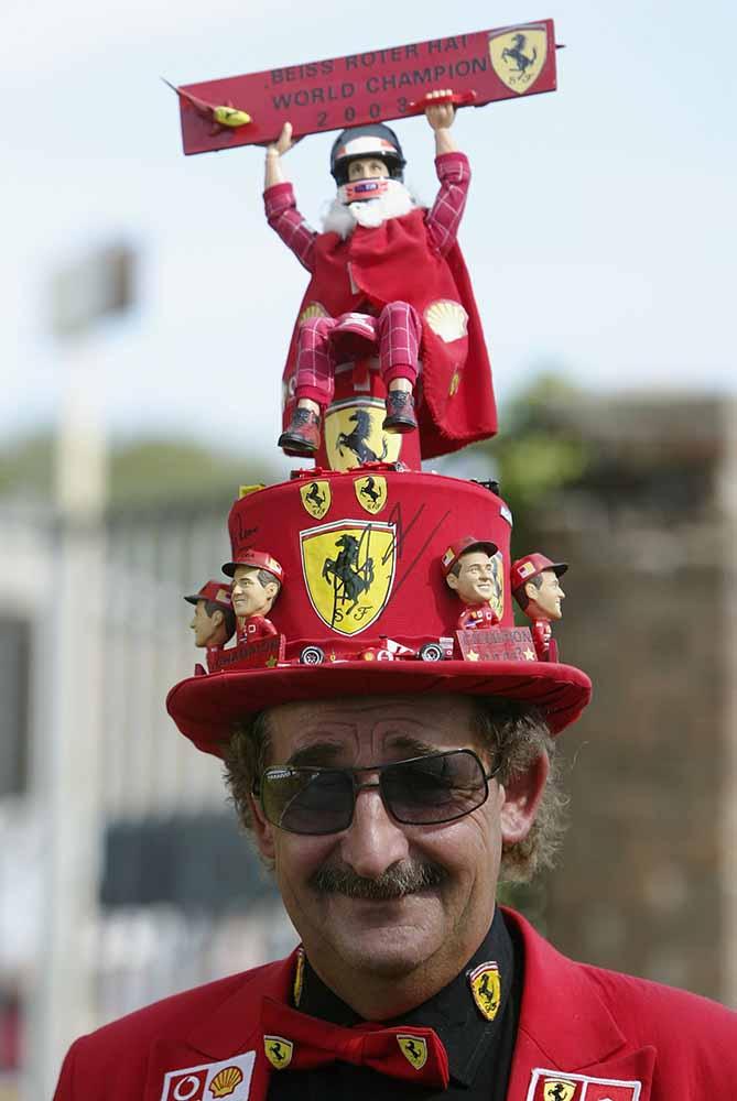 An Italian fan shows his suuport for Ferrari fine art photography