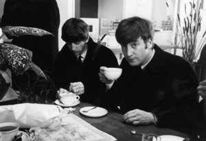 Volume 2, Page 85, Picture 7. The Beatles, October 1963. Ringo Starr and John Lennon at Stockholm airport, Sweden drinking a cup of coffee.