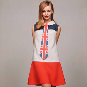 England. 1968. A model is pictured wearing a red, white and blue mini-dress with Union Jack kipper tie.