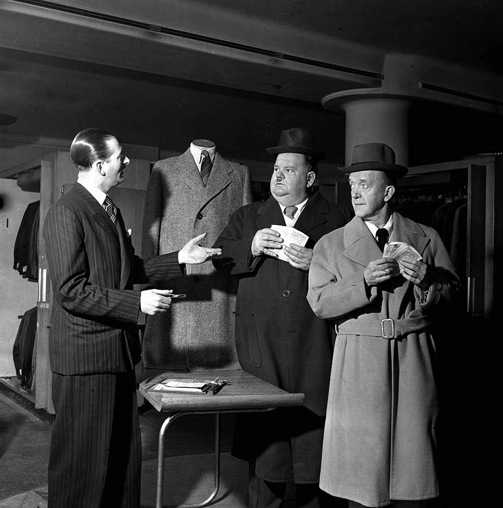 15th March 1947. American comedy duo Stan Laurel and Oliver Hardy pictured at menswear store in London's West End. fine art photography