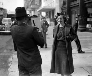 16th October 1936, London, England, American actress Bette Davis is filmed by a news cameraman