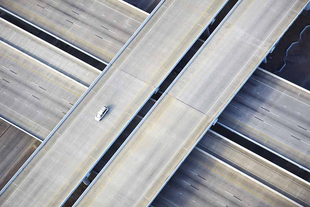 Aerial shot of one car on freeway fine art photography