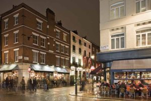 UK, London, West End, Old Compton Street at dusk