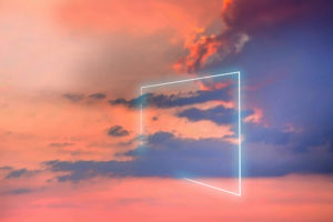 Poetic neon square light between the clouds in beautiful sunset sky.