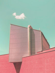 Surreal minimal architecture with geometric volumes and psychedelic colors.