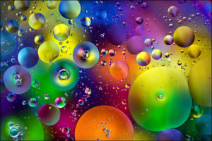 Full Frame Shot Of Multi Colored Bubbles On Glass