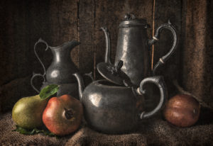 A traditionally styled still life of pewter vessels