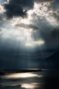 dramatic sky with sunbeams over Lago Maggiore, Switzerland