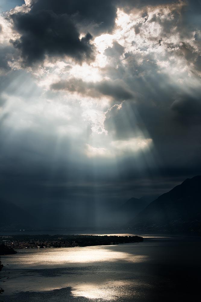 dramatic sky with sunbeams over Lago Maggiore, Switzerland fine art photography