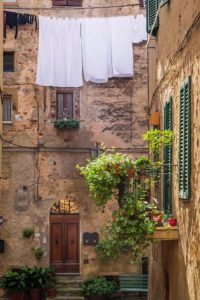 Vintage balcony on the street in Italy